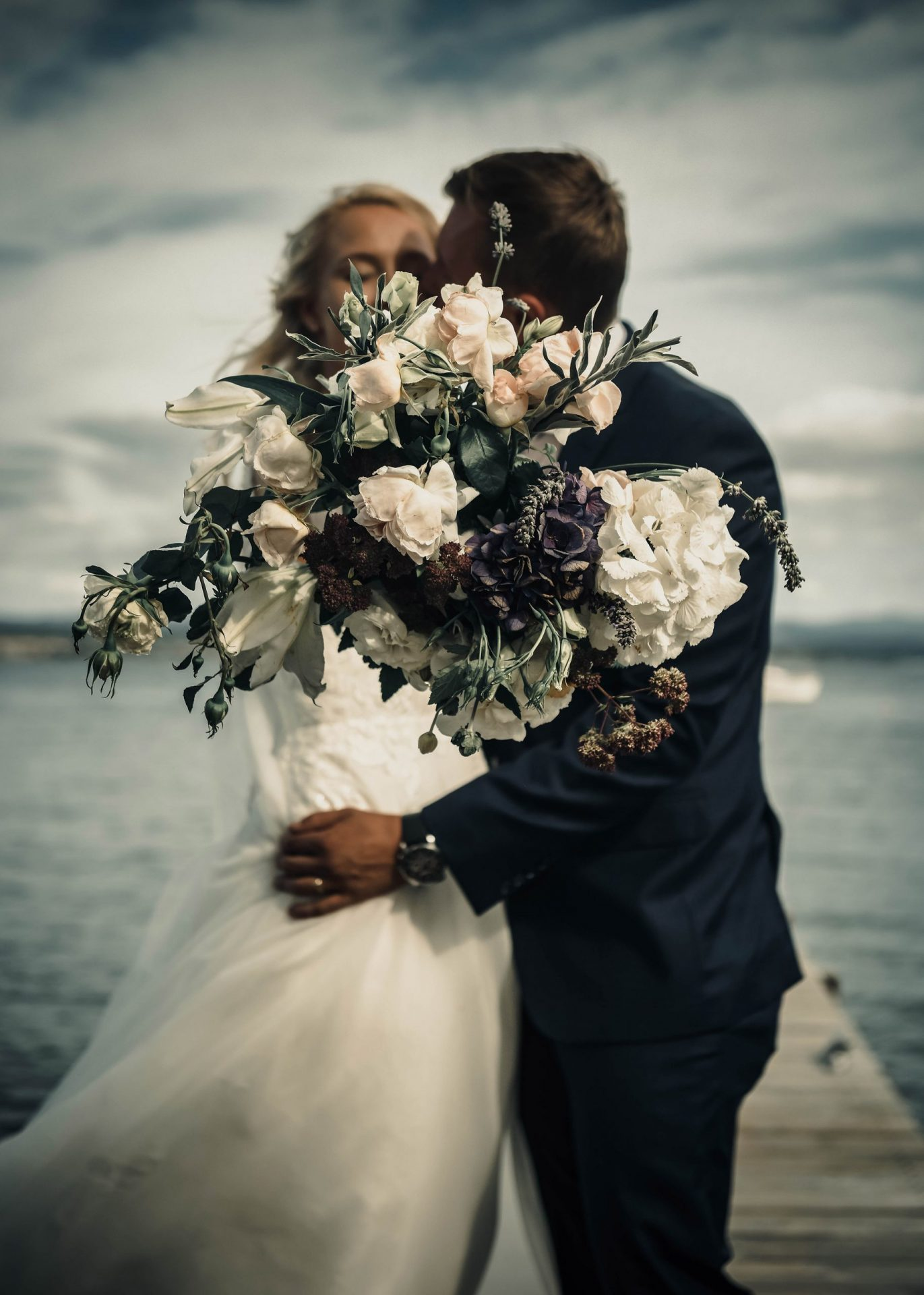 Husband And Wife Kiss On Their Wedding Day Outdoors. Love, Cheerful.