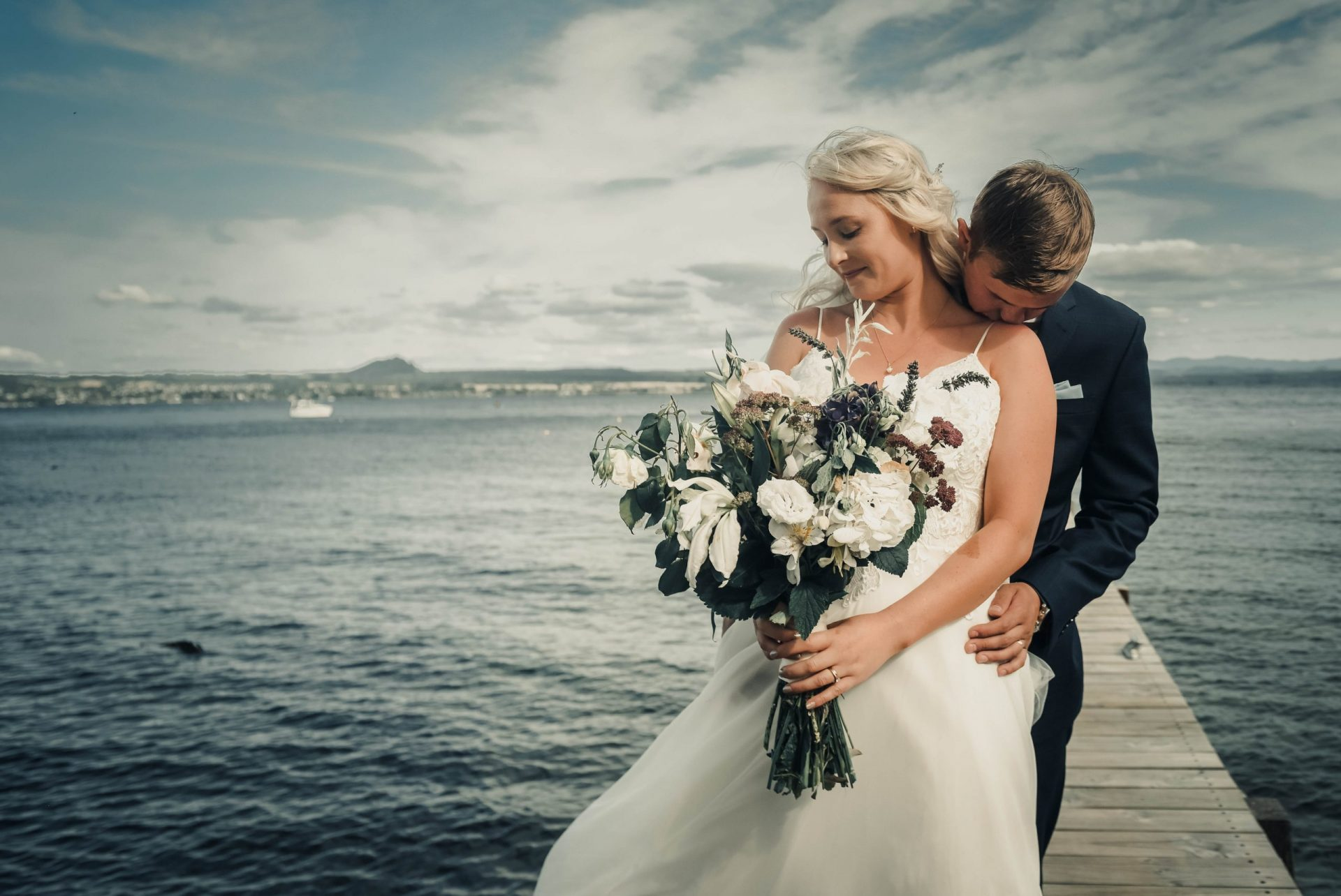 groom kissing his bride's shoulder, Wedding Photography of Crystal and Conner