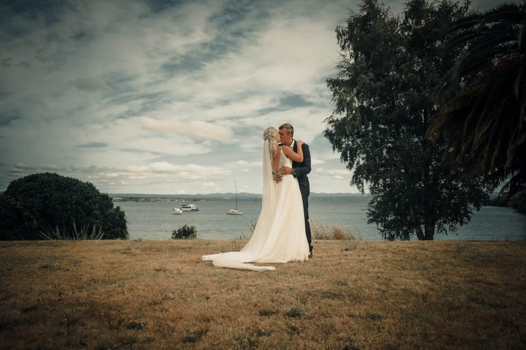 the couple is kissing each other, Wedding Photography of Crystal and Conner