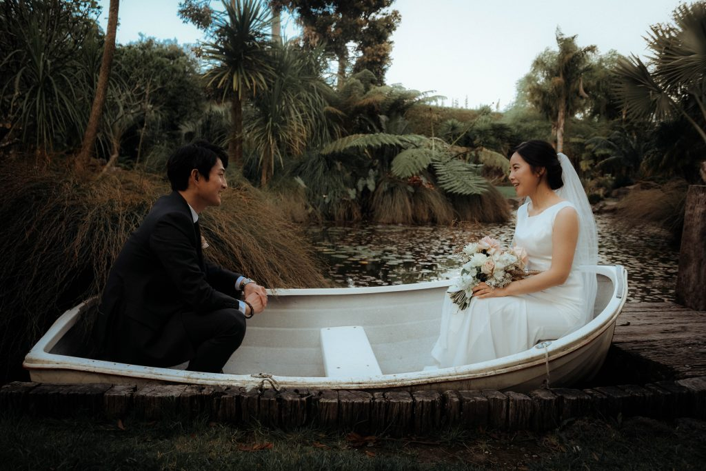 couple is sitting on a boat seeing each other, Wedding Photography of Andrew and Joon