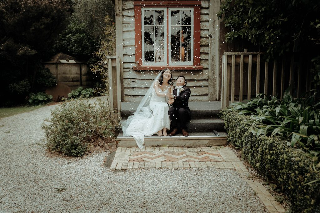 couple is sitting on stairs and celebrating their wedding, Wedding Photography of CC and Sean
