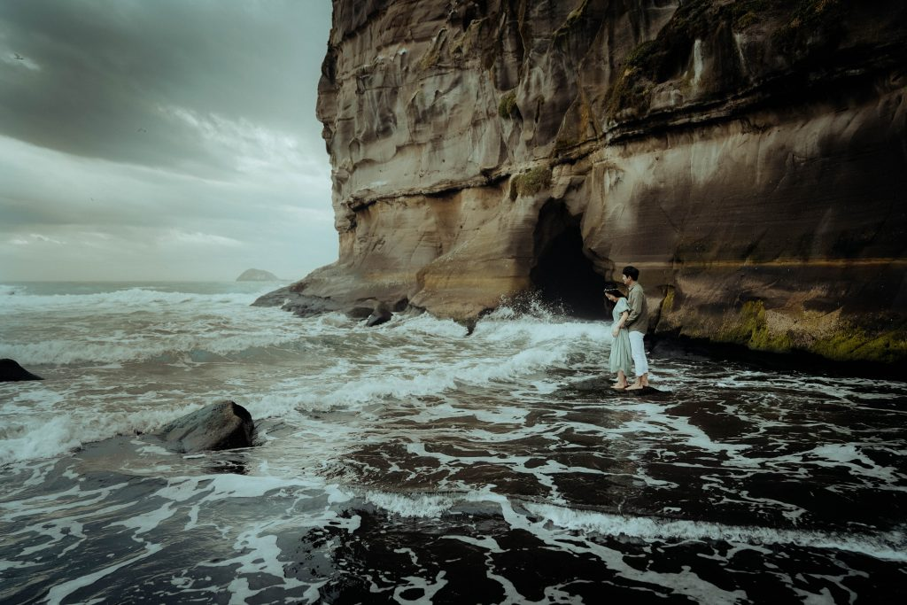 the couple is standing on a beach, Wedding photography of Andrew and Joon