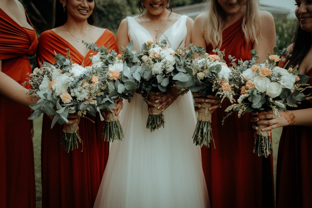 The bride and her friend are showing flowers, Wedding Photography Auckland