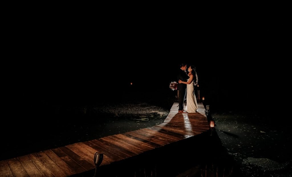 couple seeing each other's face standing on wood bridge during thier Wedding Photography Session