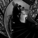Couple is standing on the stairs, Wedding Photography of Sarah and Hamzah